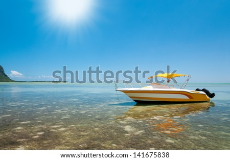 Motorboat in tropical sun - stock photo