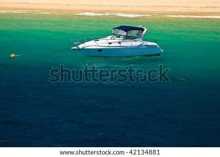 Motorboat Moored off Moreton Island Australia - stock photo