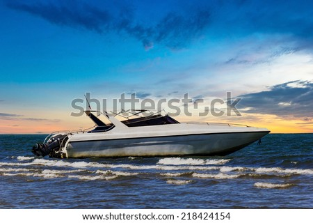 Motorboat park at beach on twilight time  - stock photo