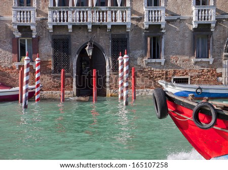 Motorboat passes by the flooded entrance of a palace on Grand Canal in Venice