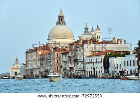 Motorboats and Venetian Architecture on the Grand Channel. - stock photo
