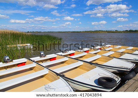 Motorboats ashore Tisza Lake in Hungary