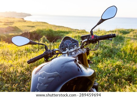 Motorcycle above the sea landscape, travel background.