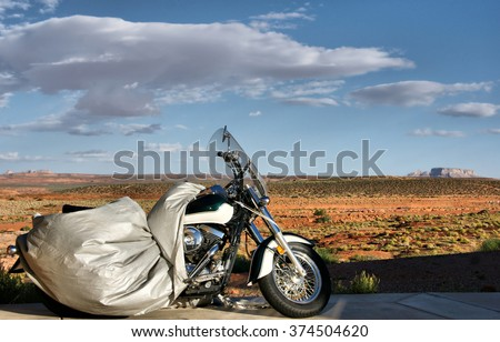 Motorcycle awaiting for its rider in the desert, Arizona, USA - stock photo