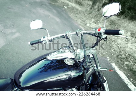 Motorcycle detail with gasoline tank and speedometer. Chrome motorcycle details close-up - stock photo