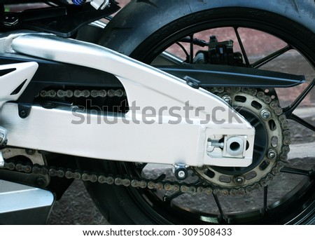 Motorcycle drive chain and arm.