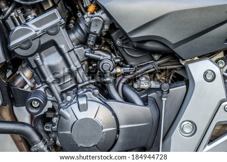 Motorcycle engine close-up detail background with shallow focus