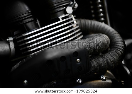 motorcycle engine head with exhaust pipes - stock photo