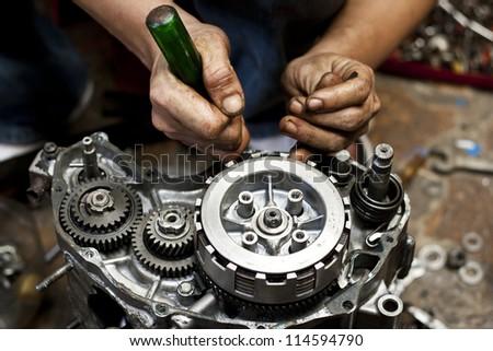 Motorcycle engine repair - stock photo