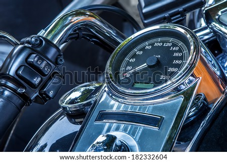 Motorcycle handlebar and speedometer closeup view. - stock photo
