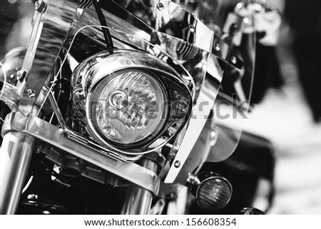 motorcycle headlight in closeup - stock photo