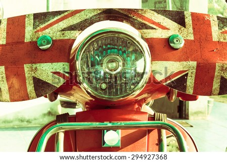 Motorcycle light and front side in vintage style. - stock photo