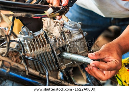 Motorcycle mechanic,Technician - stock photo