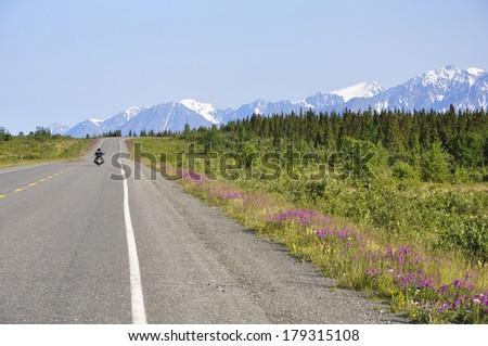 motorcycle on Alaskan highway - stock photo