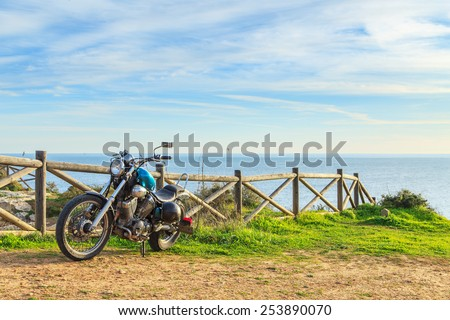 Motorcycle on the cliff with a seaview - stock photo