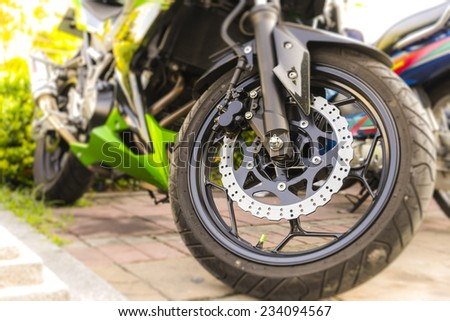 Motorcycle parking , Selective focus on front wheel