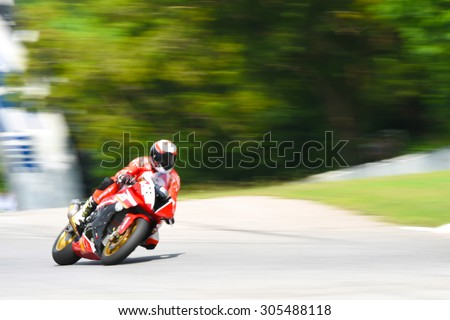 motorcycle racing -  winning leadership competing effort - blurred background motion blur - stock photo