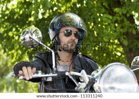 Motorcycle rider in nature portrait - stock photo