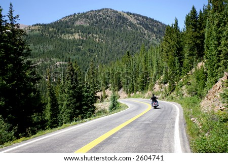 Motorcycle Rider on Mountain Road in Colorado - stock photo