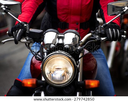 Motorcycle rider rushing at city street - stock photo