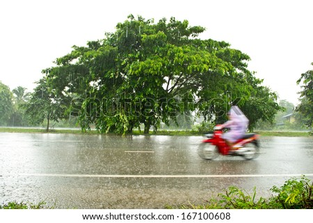Motorcycle riders on wet roads - stock photo