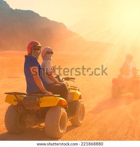 motorcycle safari egypt people travel beautiful  holiday background, extreme hobby games  speed achievement, sinai sharm desert - stock photo