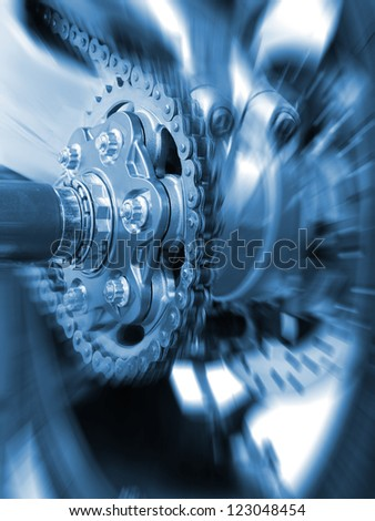 Motorcycle wheel and drive-chain detail - stock photo