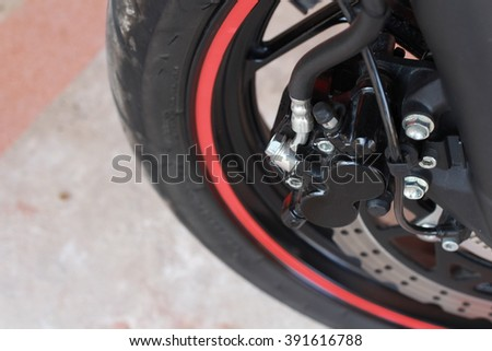 motorcycle wheel, tire and dish bake with red curve line.