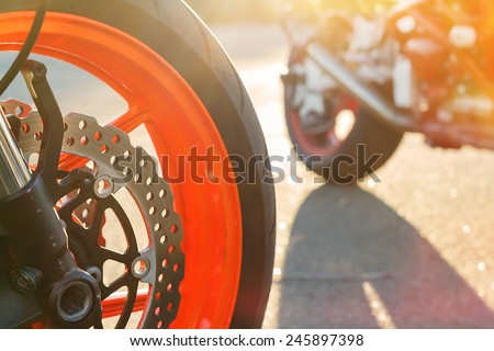 Motorcycle wheel with disc brake. Backlit - stock photo