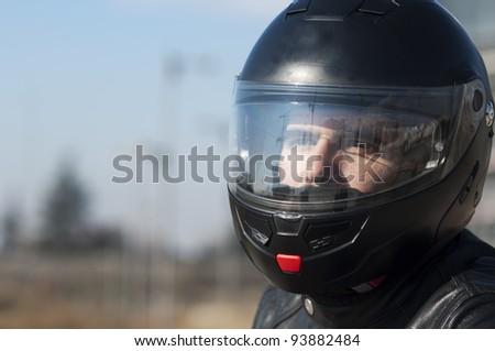 Motorcycle with his helmet - stock photo