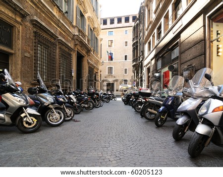 Motorcycles in streets of Rome - stock photo