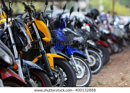motorcycles parked in row - stock photo