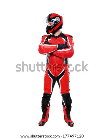 motorcyclist full length on white background looking to the side - stock photo