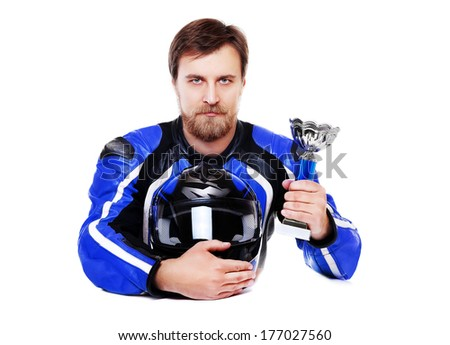 motorcyclist in blue equipment holding the trophy closeup portrait - stock photo