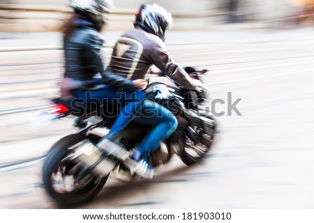 motorcyclist in motion blur - stock photo