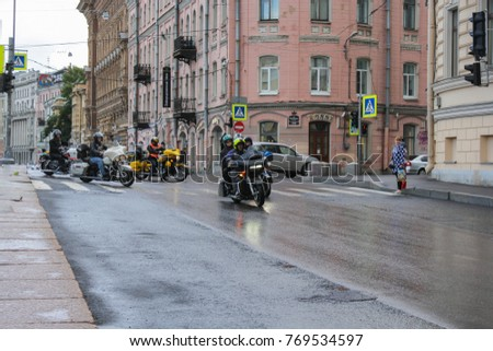 Motorcyclists on a wet road. St. Petersburg, Russia - 5 August, 2017. The annual Harley-Davidson Festival is held in the center of St. Petersburg.
