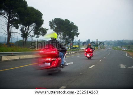 Motorcyclists riding on the road