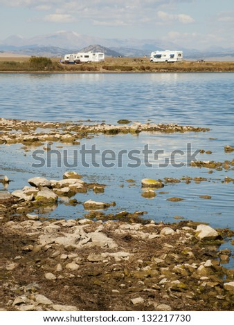 Motorhome campsite near the lake on early morning late in the season. - stock photo