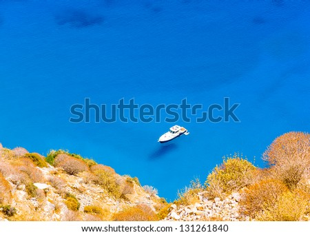 Motorized cruiser boat in the blue sea of Amorgos island in Greece - stock photo