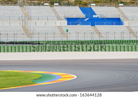 Motorsport Racetrack with skid marks and the empty seats - stock photo