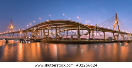 Motorway, Expressway, Freeway the infrastructure for transportation in modern city, urban view at twilight time.
