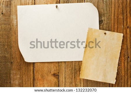 mottled beige parchment paper posters similar to the grungy cowboy wanted notices nailed to vintage wooden planks - stock photo