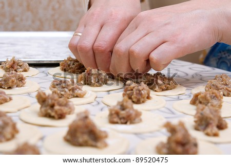 Moulding hands of pelmeni. Preparation, selective focus - stock photo