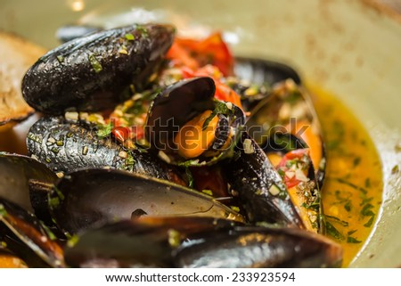 Moules Marinieres. Mussels cooked with white wine sauce. Shallow dof. - stock photo