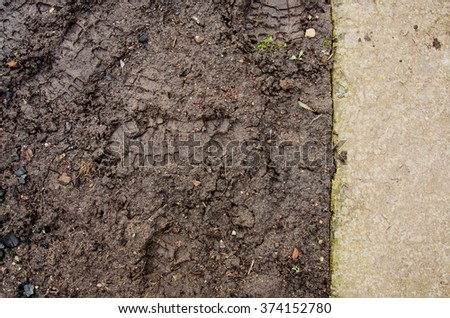 Mound construction.  Soil background. Park ground texture with rocks mulch and  dirt. Black soil texture. fine texture of brown gravel on a dirt road
