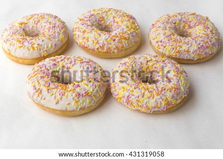 Mound of doughnuts. Crumpet for tea. Tasty food cakes. Delicious classic cakes: fried doughnuts glazed with caramel. Nutritious dish that promotes obesity. - stock photo