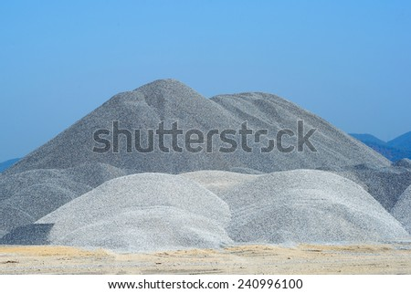 Mound of gravel for distribution to construction.