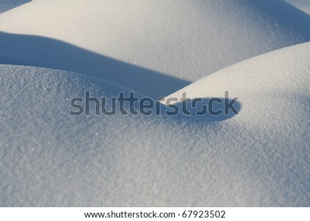 mounds of snow on a  sunny winter day - stock photo