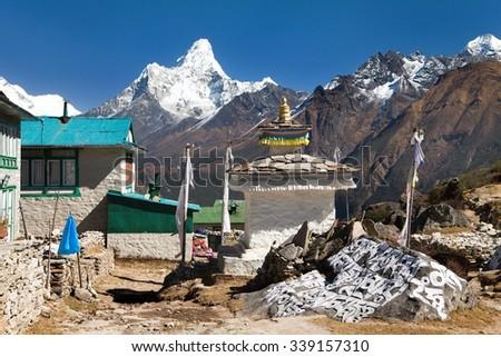 Mount Ama Dablam and Khumjung village near Namche bazar, way to Mount Everest base camp, Sagarmatha national park, Khumbu valley, Solukhumbu, Nepal - stock photo