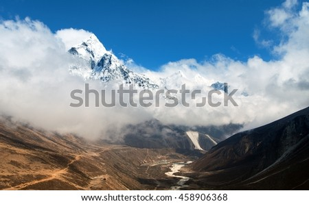 Mount Ama Dablam within clouds, way to Everest base camp, Khumbu valley, Sagarmatha national park, Everest area, Nepal